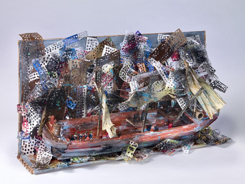 Photograph of a mixed media sculpture of a boat