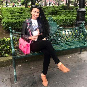 Mayra Palafox sitting on a park bench