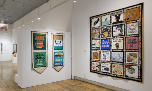 Installation photograph of two Remembrance Banners and one Community Quilt