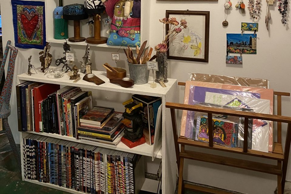 Photograph of publications and art items on display in the Intuit Store