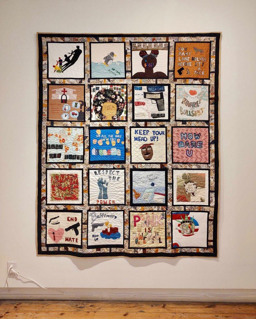 Installation photograph of a Community Quilt on view at Intuit