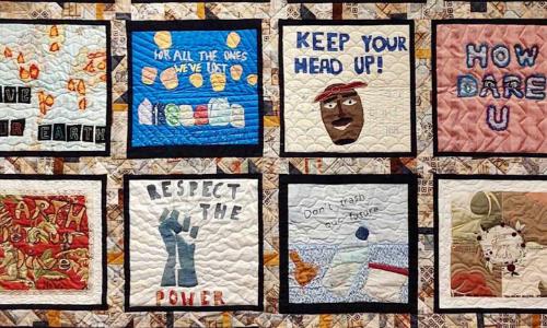 Photograph of eight blocks on an SJSA Community Quilt